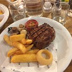Sirloin Steak with mushrooms, tomato, chunky fries and onion rings
