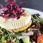 Vegetarian Warm Goats Cheese, Red Onion & Croute Salad topped with Pine Nuts & served with Potat