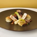 Seared loin and braised leg of rabbit, sage and onion dumplings, braised peas onions and bacon