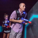 Compete in Amp Up's three-level, black-light, music-filled laser tag arena