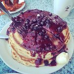 The blueberry pancakes with a fork for scale.