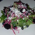 Salad with berries and citrusy dressing