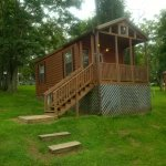 Cabin #8, covered porch w/ bench, fire pit & picnic table. B