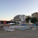 View of hotel from beach ( white building, yellow awning)