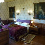 The bed department with paintings by Maria Theresia and her husband.