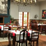 the dining room with a huge fire place