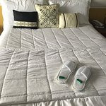 slippers and chocolates on each bed