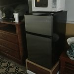 micro and refrigerator in room