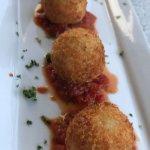 Arancini balls with spicy tomato sauce