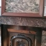 Fireplace in the living room with historic images of Hamlton