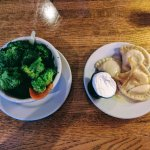 Sides of Broccoli and Pierogies