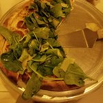 pizza. fresh spinach. sliced italian sausage
