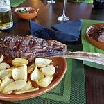 One half of sharing steak on the bone