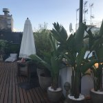 Rooftop with a small pool, relaxing areas and a bar.