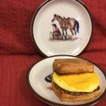 Chuckwagon Croissant Breakfast Sandwich shown with sausage, egg and American cheese