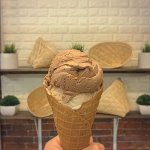 Dairy-free ice cream: scoop of cocoa + scoop of latte on fresh waffle cone (gluten-free/vegan)