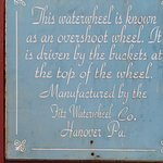 Historic Sign about the signature Waterwheel