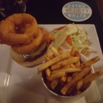 My hubby's burger-with the most giant delicious onion rings on top!