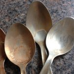 Teaspoons stained brown in cutlery drawer.