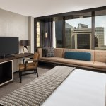 Newly renovated guest rooms and suites are appointed with an oversized plush sofa.