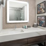 Newly renovated rooms feature sleek bathrooms with new vanities and glass-enclosed showers.