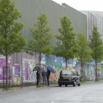 """The """"peace walls"""" separating the different communities of Belfast, and a Black Taxi."""