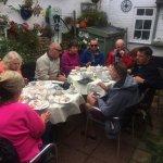 Crew mates having cream teas in the garden