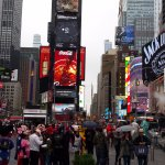 Times SQ in a quiet period. Note 3x Mickey Mouse & Batman