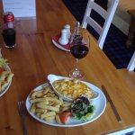 Macaroni Cheese, chips and salad.