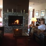 Relaxing in front of the large open fire at the lodge