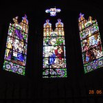 Stained glass windows behind the main altar