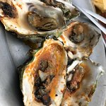 Oysters in Chipotle Bourbon Butter, which converted a purist with me.