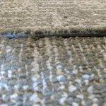 Carpet squares buckled at seams