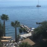 View of the private beach, jetty and beach bar at Aelos Beach Resort