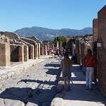 My wife strolling the streets of Pompeii with Rosemary, our guide that we booked through RomeInL