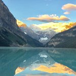 Glorious sunrise at Lake Louise with mountains and glacier in the background