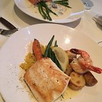 Halibut Special, 2 prawns & Sockeye Salmon Filet artichoke ravioli, asparagus, mushrooms vin bla