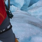 Peeking down the massive moulin in the glacier.