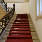 A luxurious red carpet staircase leads guests to the 2nd floor from the lobby
