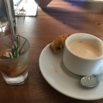 Shot glass has tiny piece of lobster and the espresso cup has bisque
