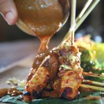 """"""" Labak Sari Chicken Satay """"is our traditional Balinese satay with peanut sauce come with cucumb"""