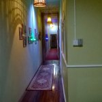 Corridor with antik Chinese wood floor and photo gallery