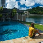 Rike Rg relaxes by the Manta Ray Bay Resort pool in her Tim Rock Ocean Dreams Pacific shirts.