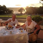 Romantic sunset dinner for two on hotel terrace with the Iguana Falls right there