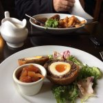 Scotch egg, black pudding and tomato chutney -- Cumberland sausages and chips