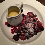 frozen fruit and white chocolate sauce