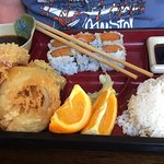 Lunch box of tempura vegetables and shrimp, sticky rice, dipping sauce, spicy white tail tuna su