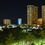 View from the lanai looking at Hilton Resort at night