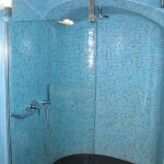 Large shower with modern fixtures..Aegean Sea colors used