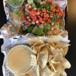 Large queso and a chicken burrito bowl.